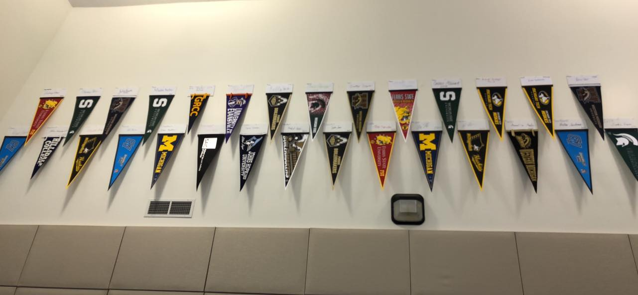 College pennants from past RoboDawg graduates hang in our robotics center.  Pennants shown are from 2014 & 2018.